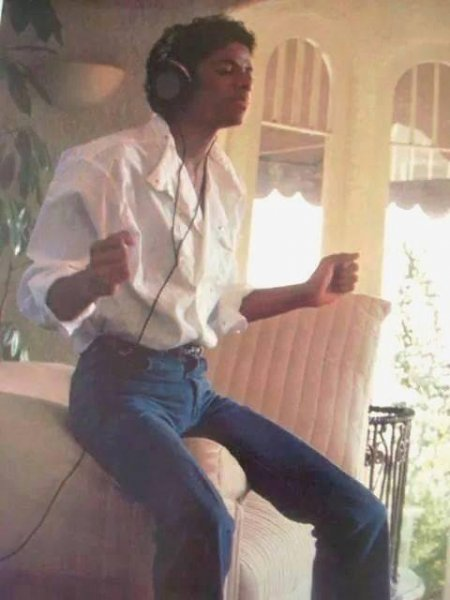 MJ singing with headphones at home
