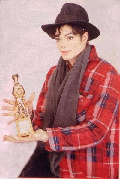 Michael holding an award