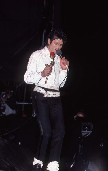 Michael in concert ca 1980 holding a red rose