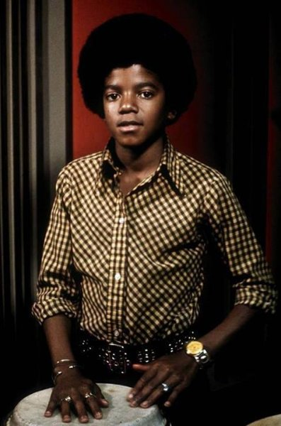 Young Michael in brown shirt