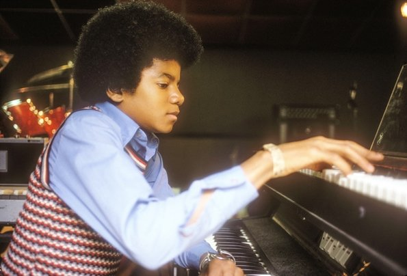 Young Michael playing the piano