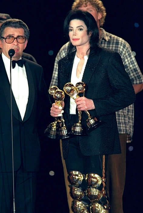 Michael accepting award from Prince of Monaco