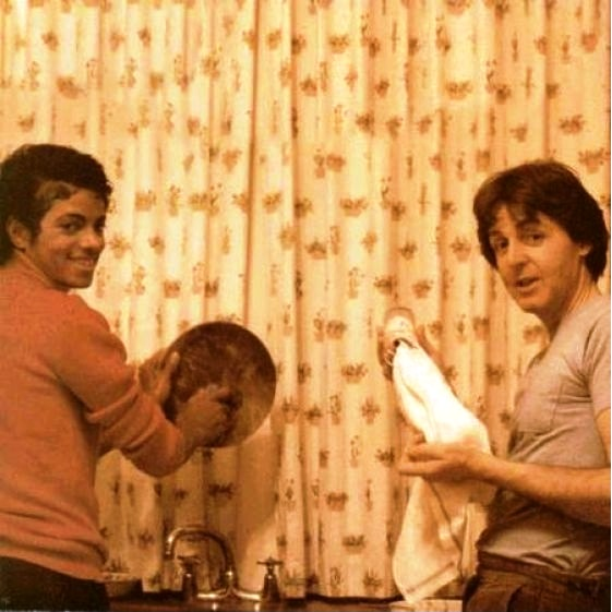 Michael and Paul McCartney doing dishes