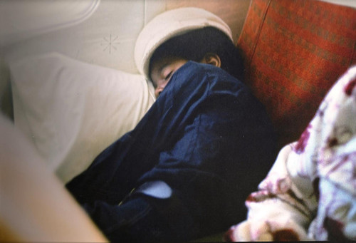 Michael sleeping on plane in 1970
