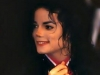 MJ in red shirt and black suit