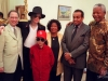 Michael with his parents and Nelson Mandela