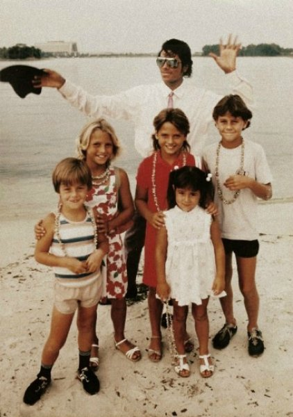 Michael at sea side with children.jpg