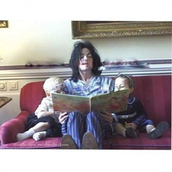 Michael reading book photo by Debbie Rowe