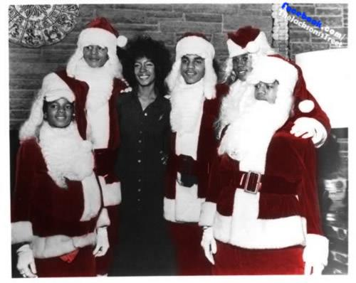 michael-dressed-as-santa-with-brothers