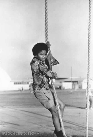 Michael climbing rope